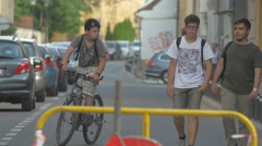 Boys walking on a street in Cluj-Napoca Stock Footage