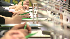 The hands of the politicians at the meeting . - stock footage