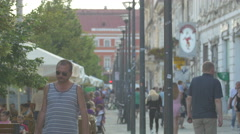 Walking by an outdoor restaurant on Heroes Boulevard, Cluj-Napoca Stock Footage