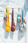 Hand made coloured bags hanging on white wall Stock Photos