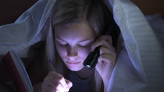 Teenager writing in her diary with flashlight Stock Footage