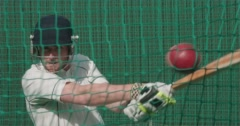 Cricketer plays shot towards camera in nets. Stock Footage