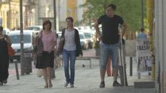 Two women walking on Heroes Boulevard, Cluj-Napoca Stock Footage