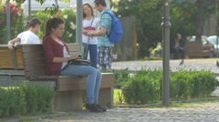 Woman sitting on a bench in Avram Iancu Square, Cluj-Napoca Stock Footage