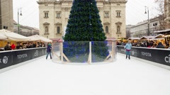 Ice scatting around Christmas Tree in the Central Christmas Market In Budapest Stock Footage