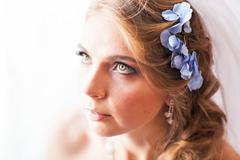 Portrait of beautiful young woman with flowers in hair. Make up and hair style Stock Photos