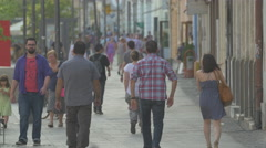 Men and women walking on Bulevardul Eroilor, Cluj-Napoca Stock Footage