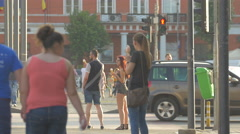 People walking and waiting to cross the street  in Cluj-Napoca Stock Footage
