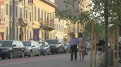 Couple walking on Heroes Boulevard, Cluj-Napoca Stock Footage