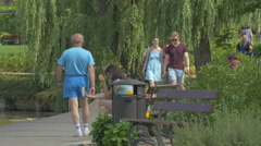 Walking on the waterfront in Iulius Park in Cluj-Napoca Stock Footage