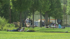 Walking and lying down in Iulius Park in Cluj-Napoca Stock Footage