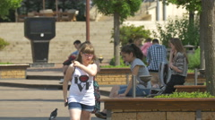 Resting on benches in Iulius Park in Cluj-Napoca Stock Footage