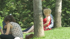Photographer taking pictures of a couple in Iulius Park in Cluj-Napoca Stock Footage