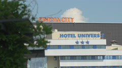 Univers T Hotel and Cinema City signs in Iulius Park in Cluj-Napoca Stock Footage