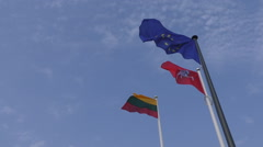 National Lithuanian and European Union EU flags waving in the sky Stock Footage