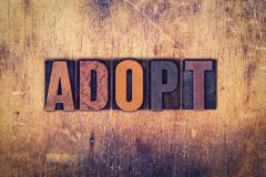 Adopt Concept Wooden Letterpress Type - stock photo