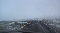 Driving car on rainy slippery road,going to Djúpalónssandur Stock Footage