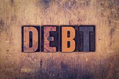 Debt Concept Wooden Letterpress Type - stock photo