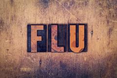 Flu Concept Wooden Letterpress Type Stock Photos