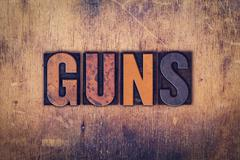 Guns Concept Wooden Letterpress Type - stock photo