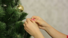 Woman decorates christmass tree Stock Footage