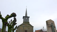 Pigeon on church roof, small french village - winter day - zoom in Stock Footage