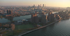 Helicopter view of Roosevelt Island, Brooklyn and the Queensboro Bridge Stock Footage