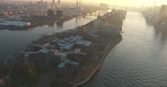 Helicopter shot of Roosevelt Island. Flying down the East River at Sunset Stock Footage
