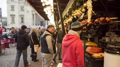 Tourists in the Central Christmas Market, Budapest, Hungary. Pan Right Stock Footage
