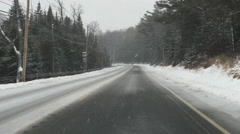 Driving On Icy Roads In Remote Forest in Winter Snow Storm POV Stock Video Stock Footage