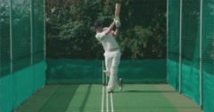 Cricketer hits ball hard in nets. Stock Footage
