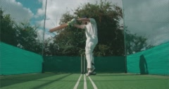 Cricketer plays shot in nets. Stock Footage