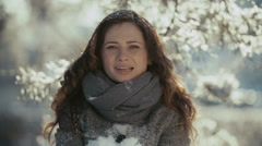 Young woman blowing snow in slow motion Stock Footage