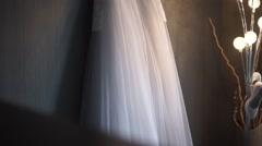 Wedding dress hanging on a hanger - stock footage