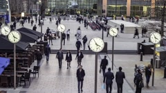 Timelapse of people with clocks - stock footage