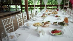 Beautifully laid tables for a wedding Banquet. Stock Footage