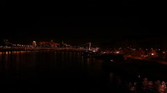 Budapest at night - city lights over Danube river Stock Footage