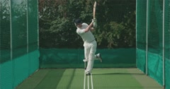 Cricketer hits a great shot in nets. Stock Footage