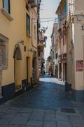 Narrow street between italian houses in old town of Tropea Stock Photos