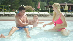 SLOW MOTION: Young family enjoying summer vacation in water park - stock footage