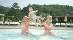 Happy father throwing smiling baby boy up in the air - stock footage