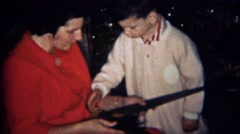 1969: Mother gives boy Christmas gift of sharp metal saw. BOULDER, COLORADO Stock Footage