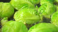 Roasting Brussels sprouts macro dolly shot - stock footage