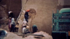 1959: Exterior adobe style building repair by women of the community. PORTLAND, - stock footage