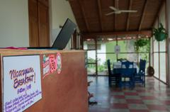 Lobby entrance of a cute hostel with laptop, table, chairs and ventilator Stock Photos