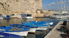 Fishing and sailing boats docked in the port of Gallipoli Stock Footage