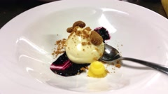 White chocolate pannacotta dish, at a restaurant kitchen Stock Footage