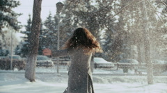 Young woman enjoying winter day outdoors. snow winter dream. sunny winter day Stock Footage