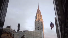 Chrysler Building tilting down to Grand Central Station Terminal early evening - stock footage
