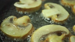 Frying field mushrooms close up dolly shot - stock footage